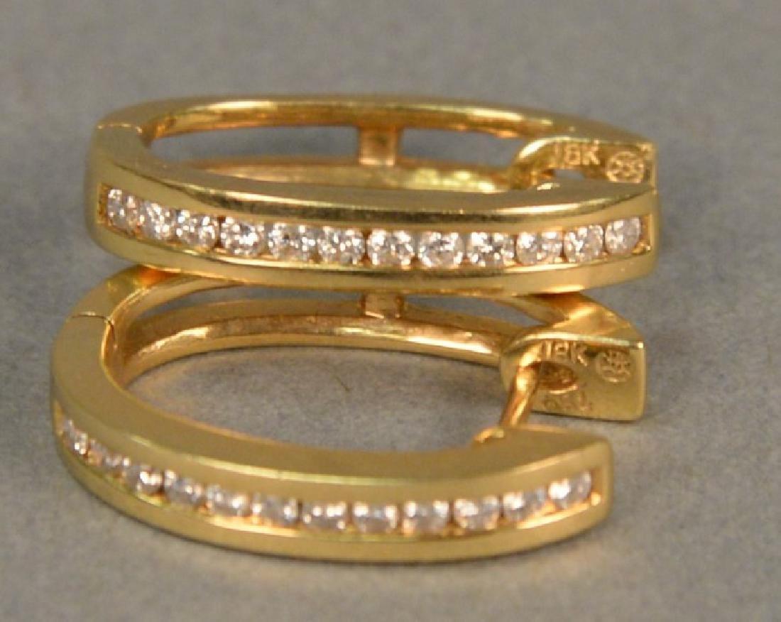 "14K yellow gold and diamond channel set ""huggie"""