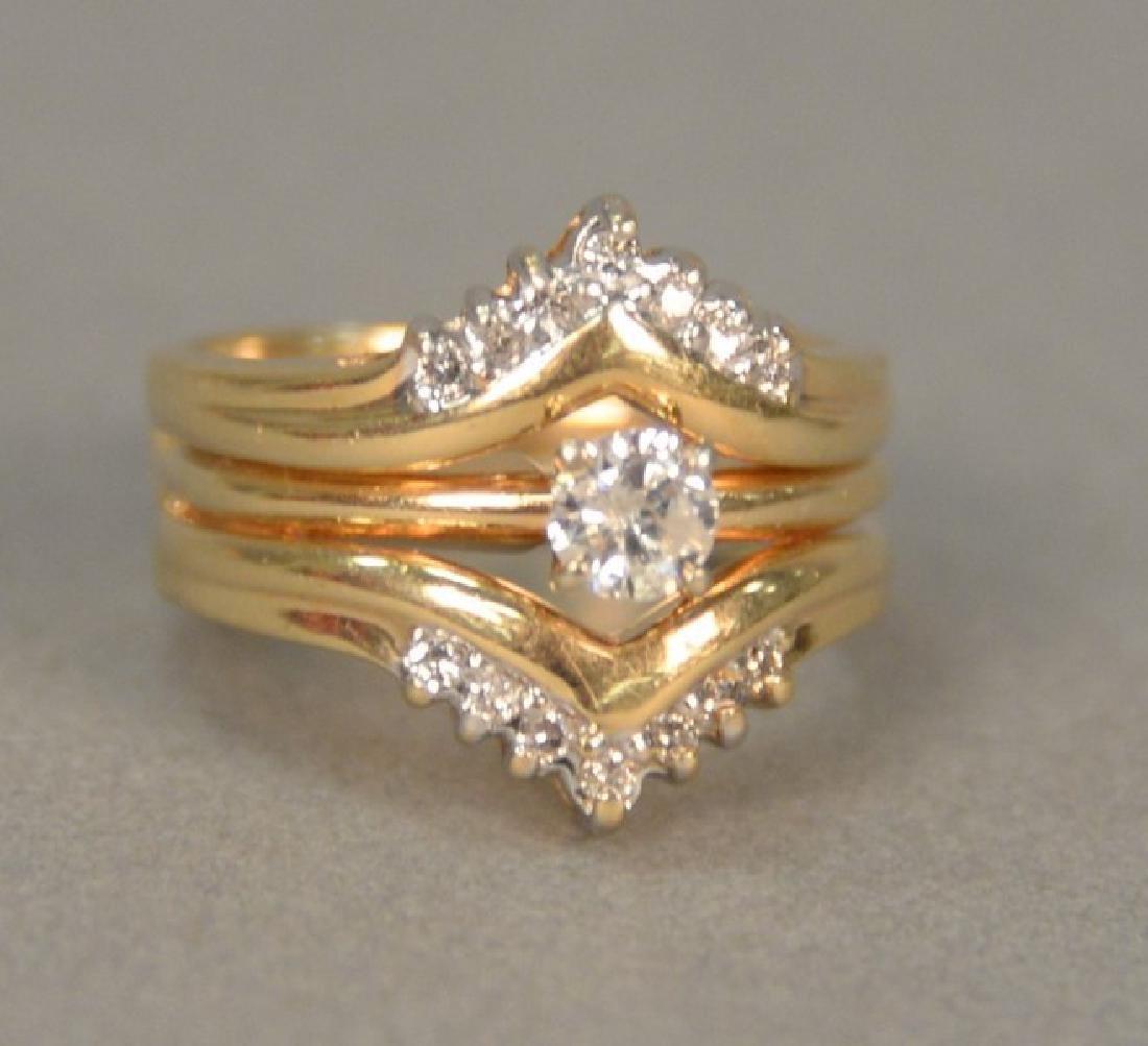 14K diamond ring with diamond insert.