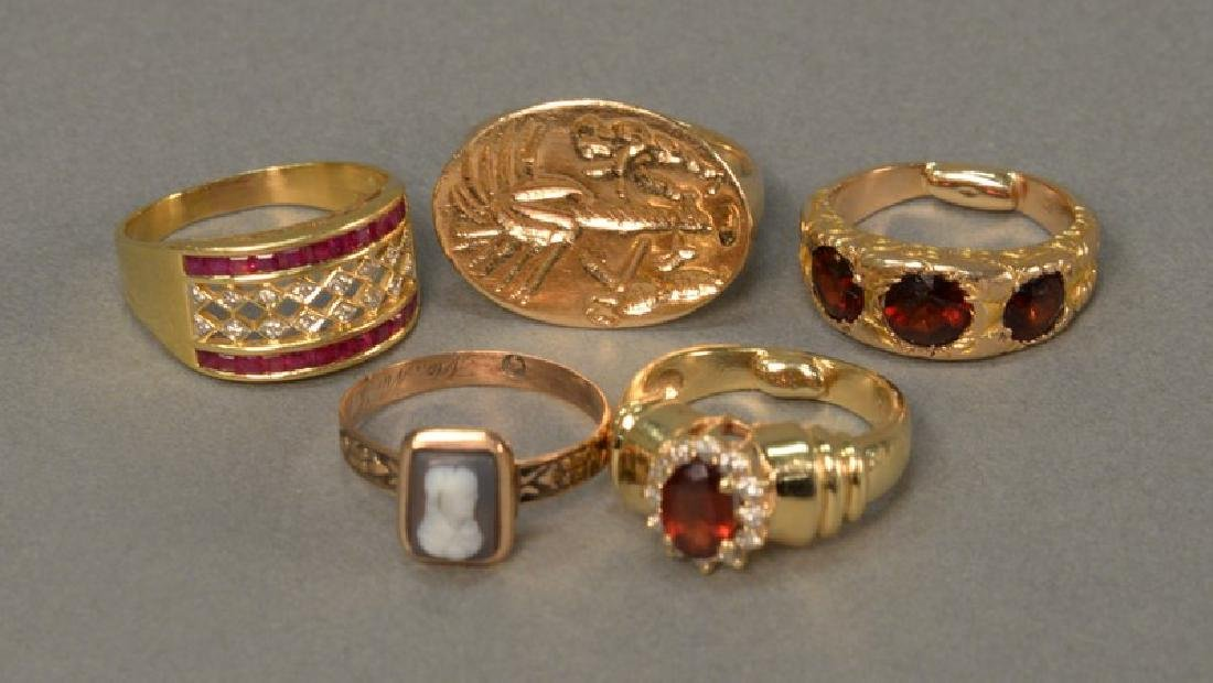 Five rings, 14K and 18K set with stones and cameo. 27.7