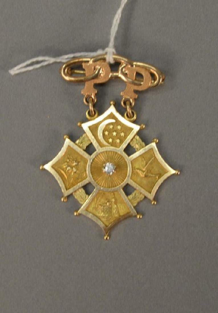 14K gold medal/pin with diamond in middle. 14.6 grams