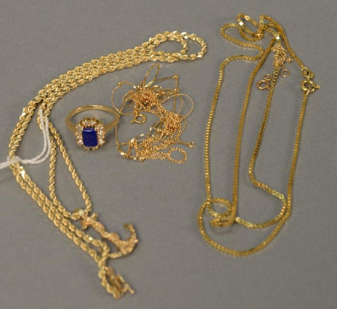 Six piece lot with 14K gold chain having anchor pendant
