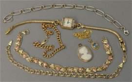 Eight piece lot including four 10K gold bracelets, one