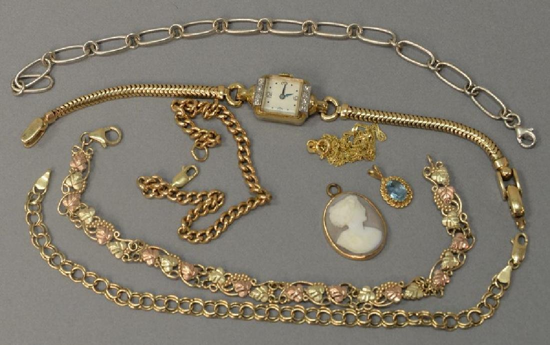 Eight piece lot including four 10K gold bracelets, one