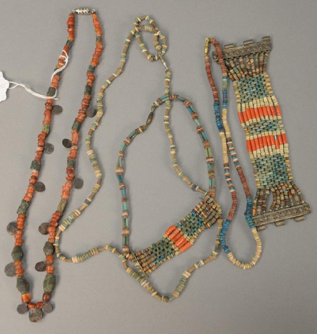 Group of five Egyptian Faience necklaces and bracelets.