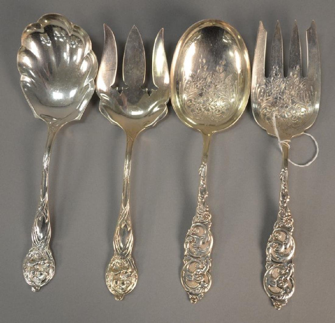 Two pairs of sterling silver serving sets, forks and