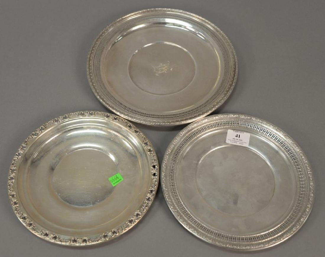 Three sterling round trays. dia. 11in., 9 1/2in., & 9