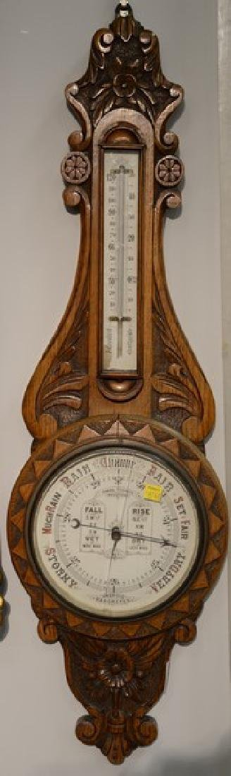 Carved oak Aneroid barometer. ht. 35in.