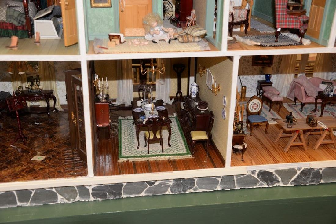 Large doll house on stand with twelve fully furnished - 12