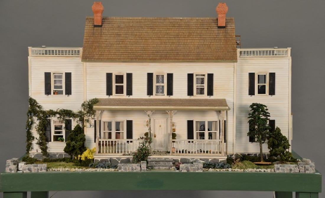 Large doll house on stand with twelve fully furnished
