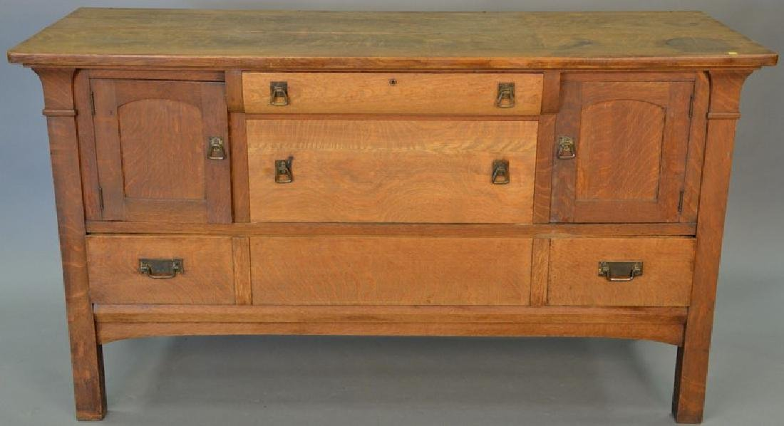Mission oak sideboard having three drawers and two