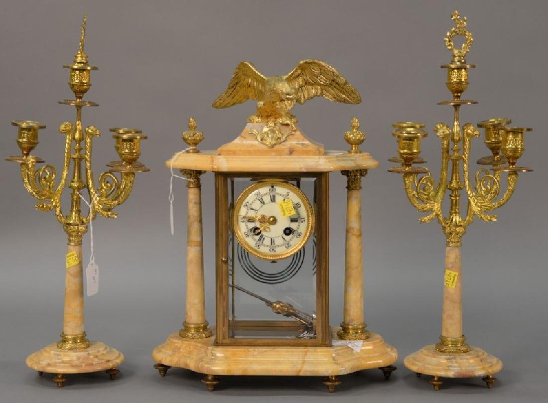 Three piece marble, crystal, and brass clock set (one