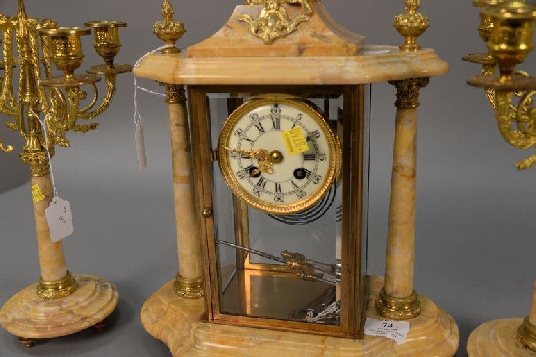 Three piece marble, crystal, and brass clock set (one - 3