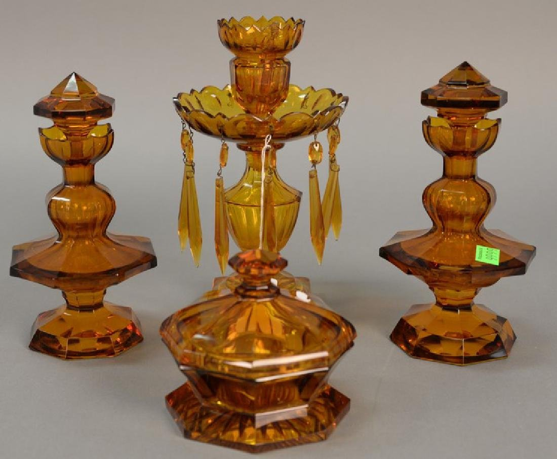 Four piece amber glass set, pair of crystal bottles