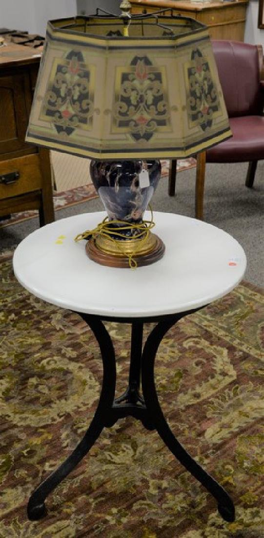 Two piece lot to include an iron parlor table with