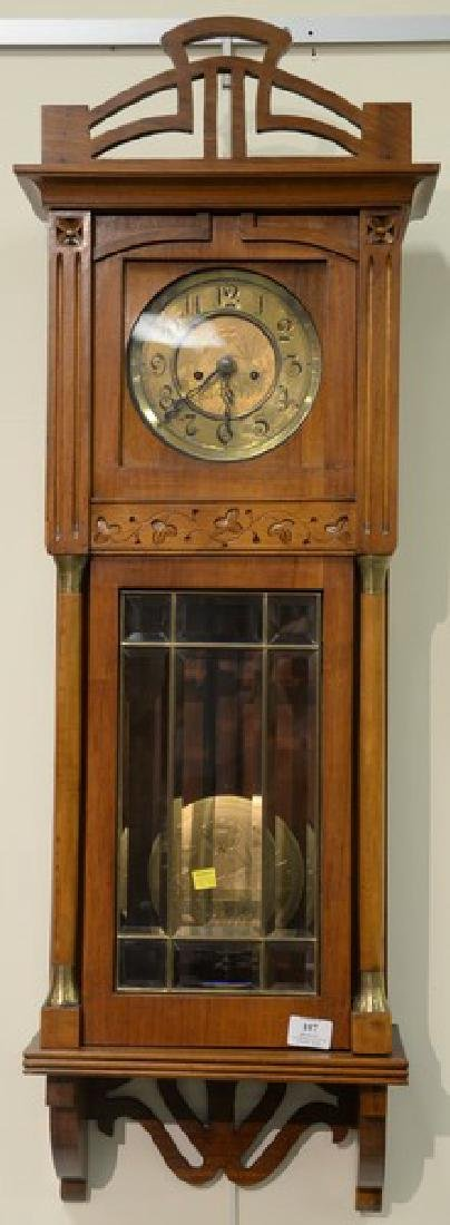Walnut regulator clock with brass dial and two brass