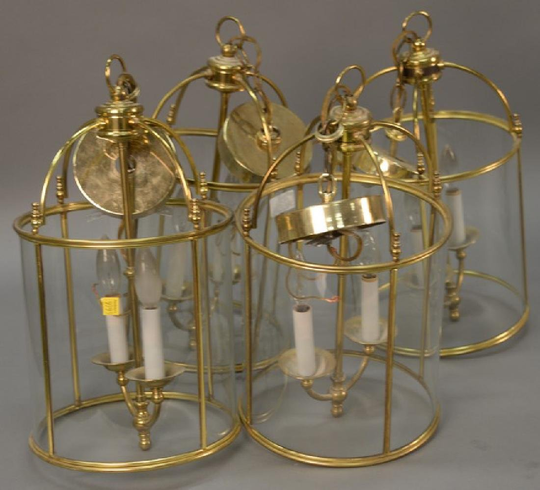 Set of four brass and glass two light hanging lights.