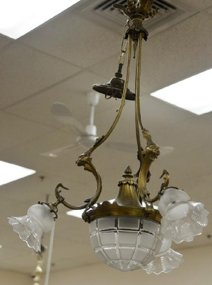 Two hanging lights including one Victorian oil lamp