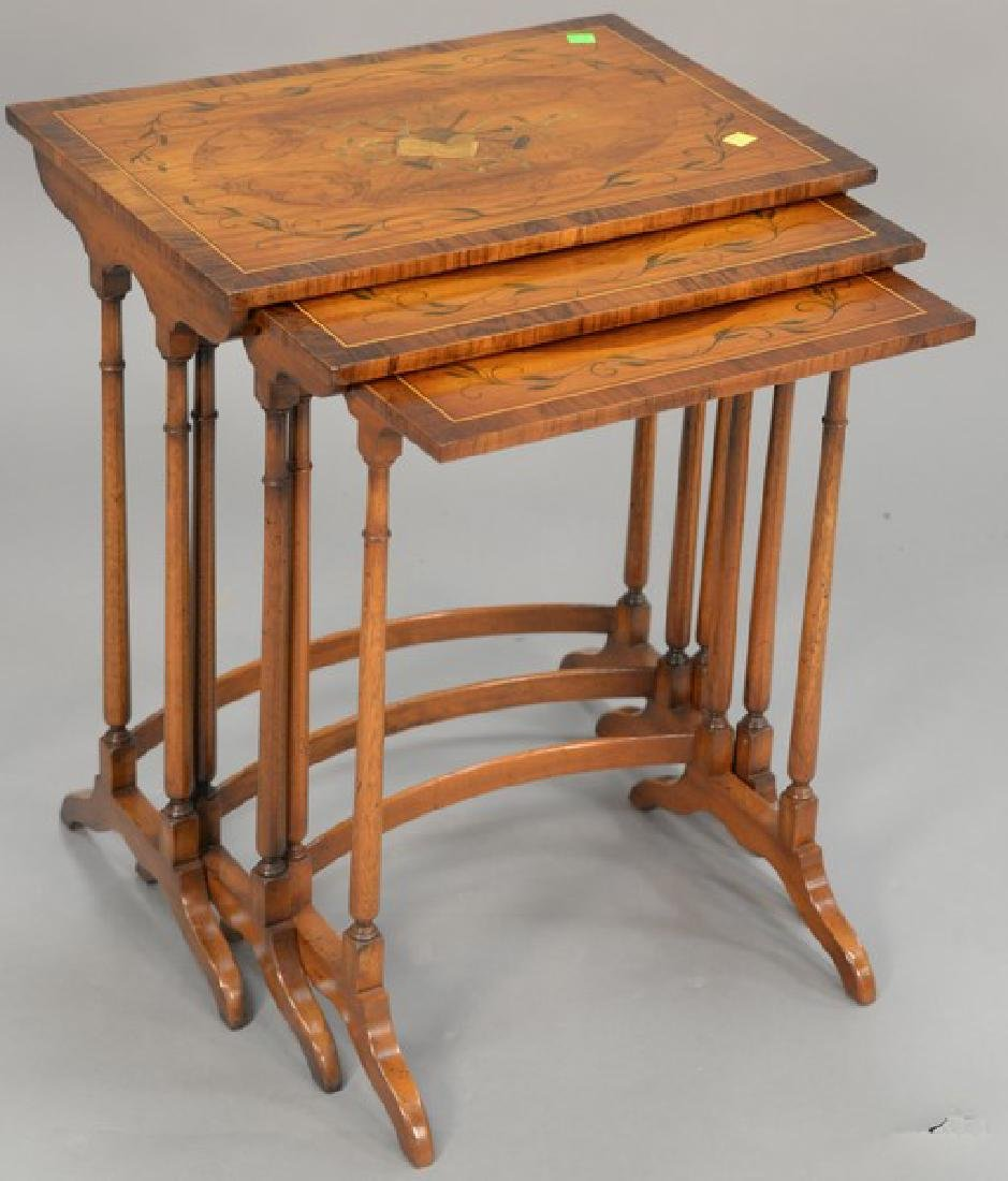 Nest of three paint decorated tables (ht. 22 1/2in.,
