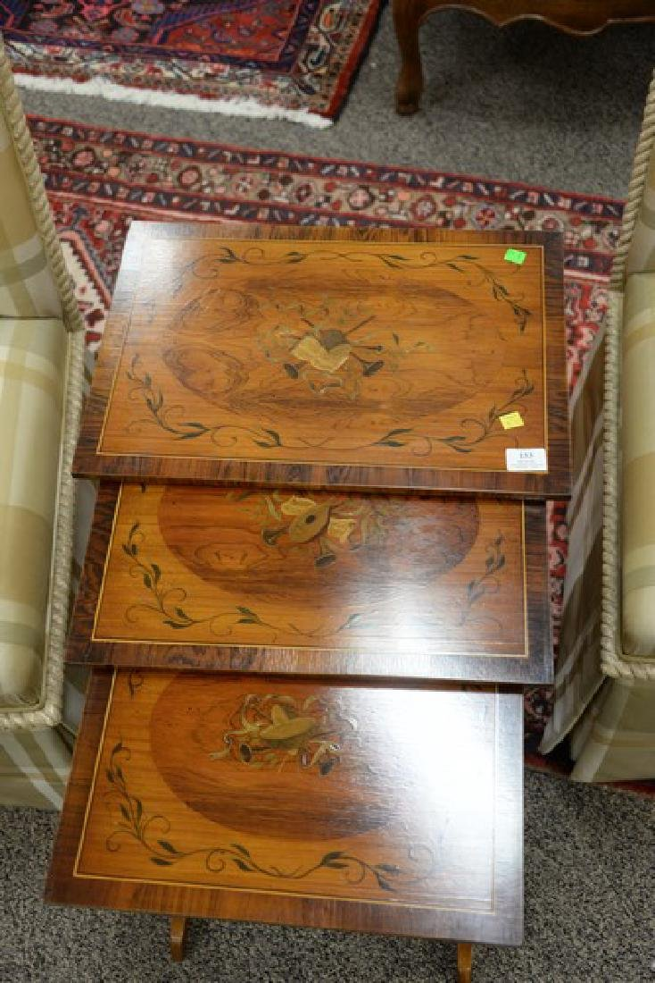 Nest of three paint decorated tables (ht. 22 1/2in., - 3
