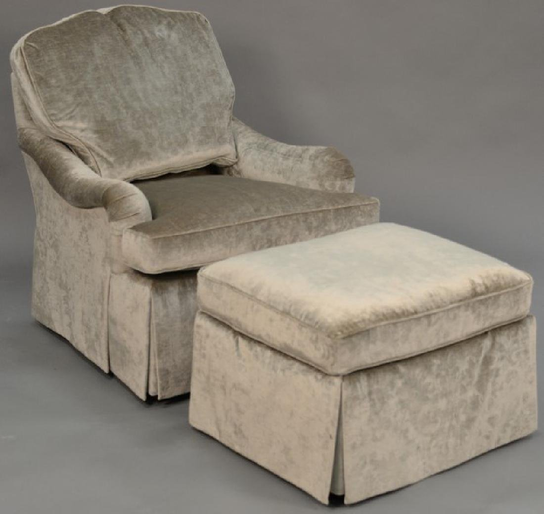 Baker upholstered chair and ottoman.
