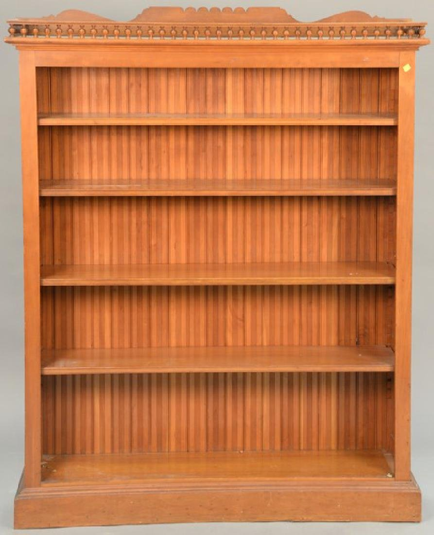 Victorian bookcase with spindle gallery. ht. 64in., wd.