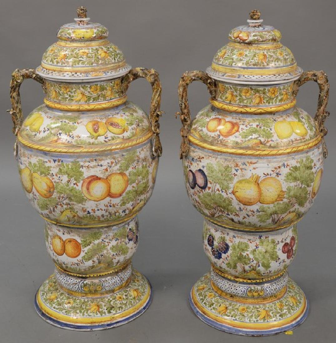 Pair of large Italian Majolica covered urns with