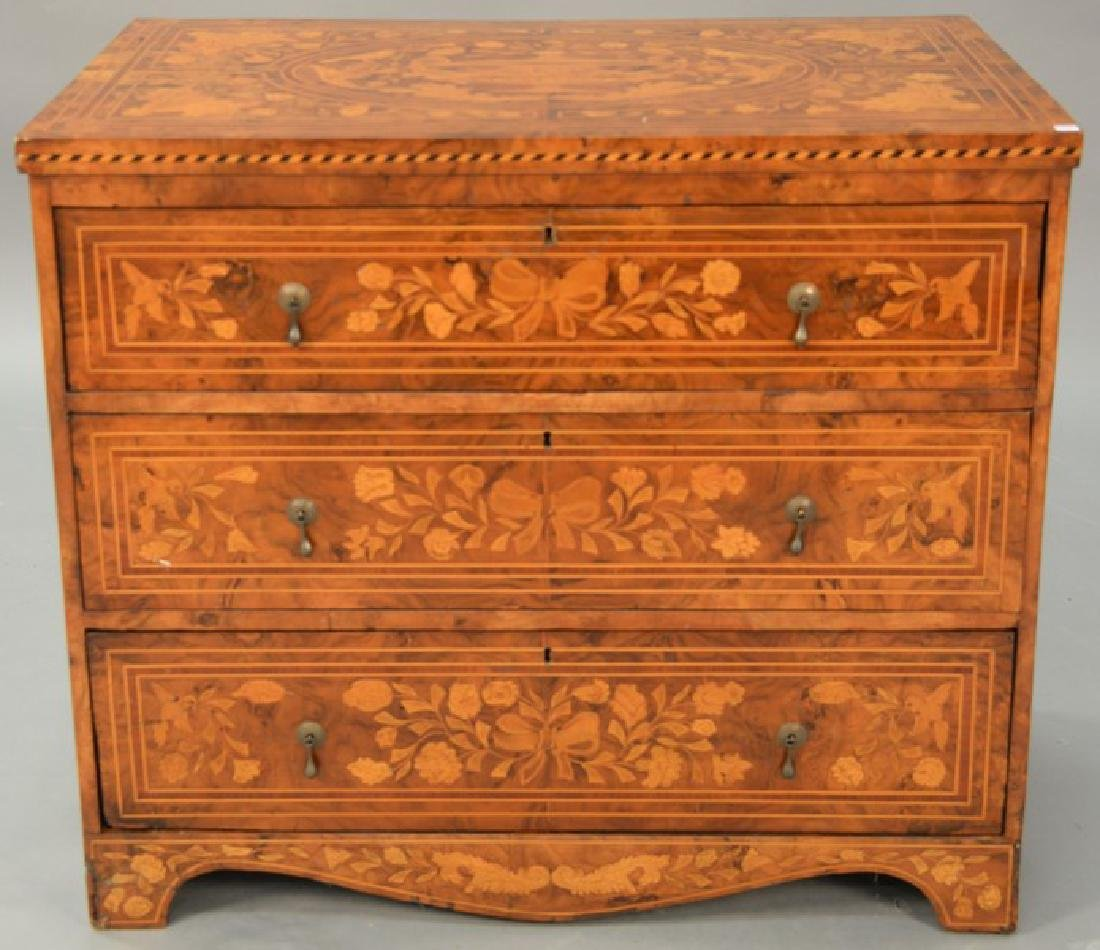 Continental marquetry inlaid three drawer chest, top