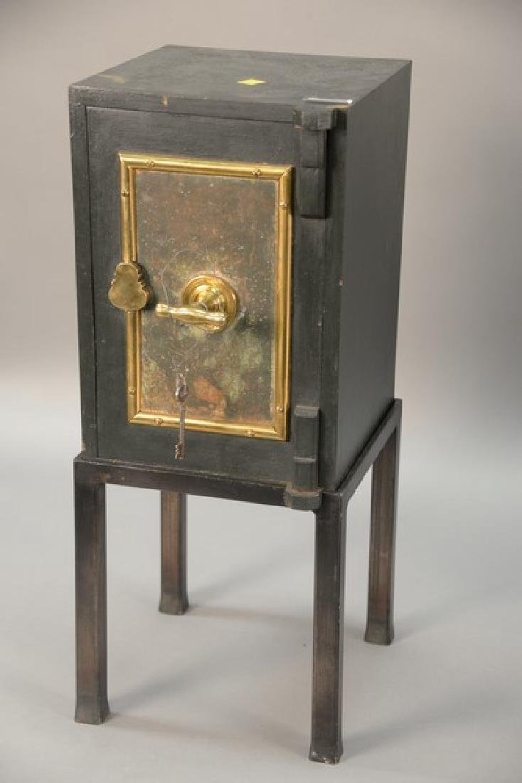 Diminutive safe on stand with key lock and brass. ht.