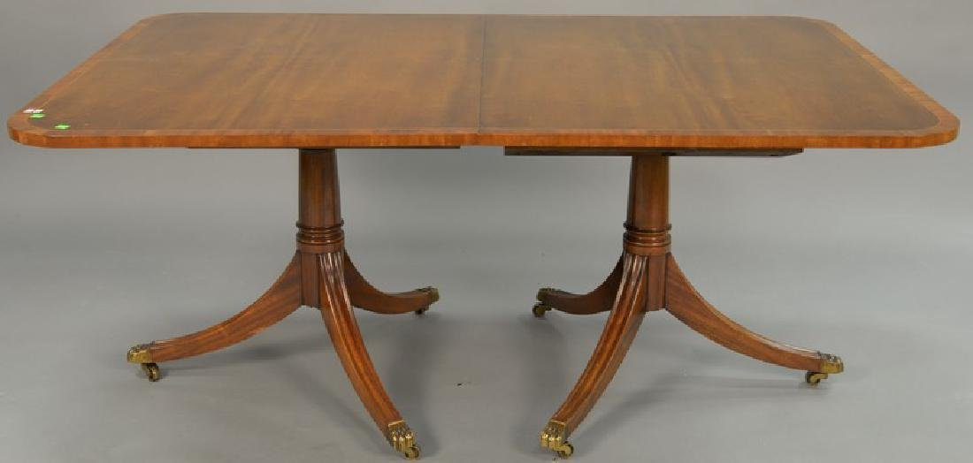 Mahogany double pedestal dining table having banded