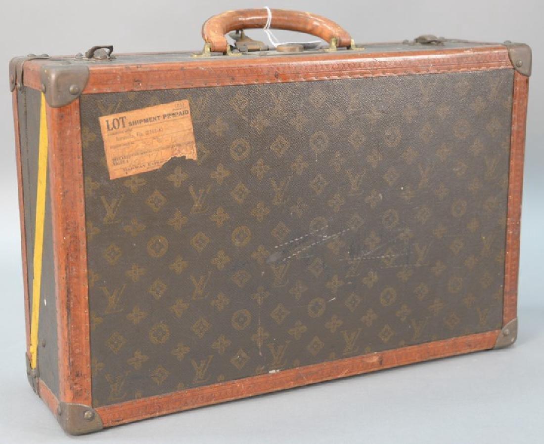 Louis Vuitton suitcase with label inside Louis Vuitton,
