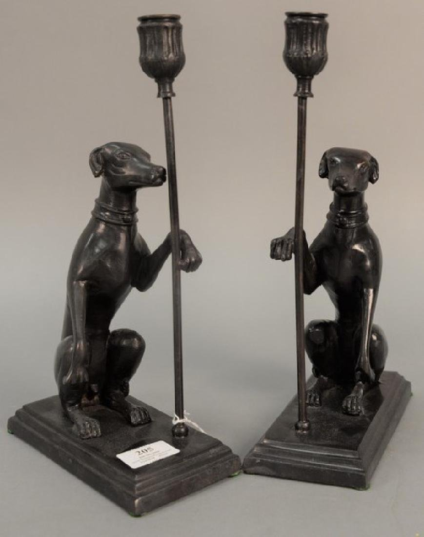 Pair of Maitland Smith bronze dog candle holders having