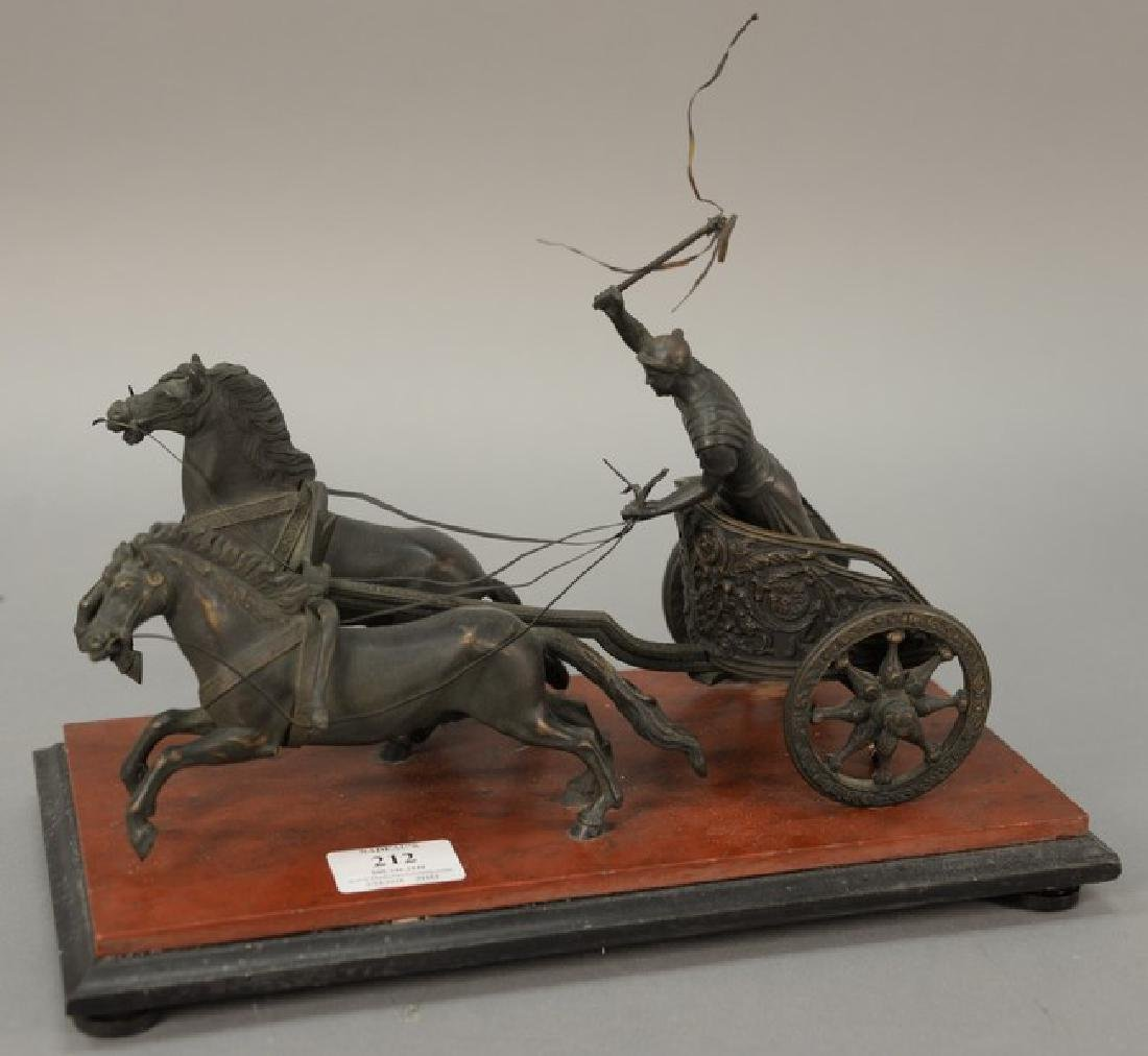 Bronze Roman chariot and rider pulled by two horses,