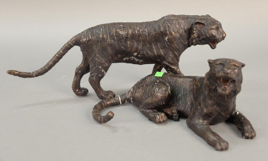 Two bronze tiger figures, one lying down (lg. 13