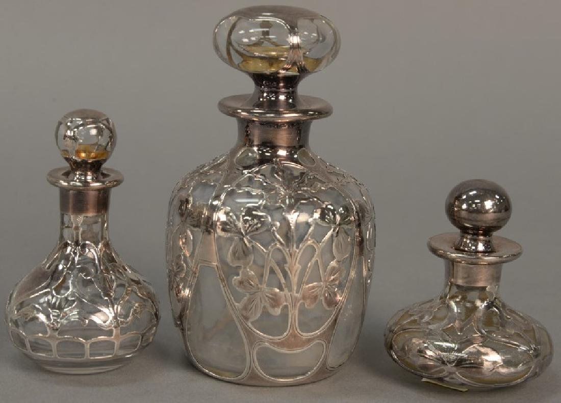 Three silver overlay cologne bottles. ht. 3in. to 5in.
