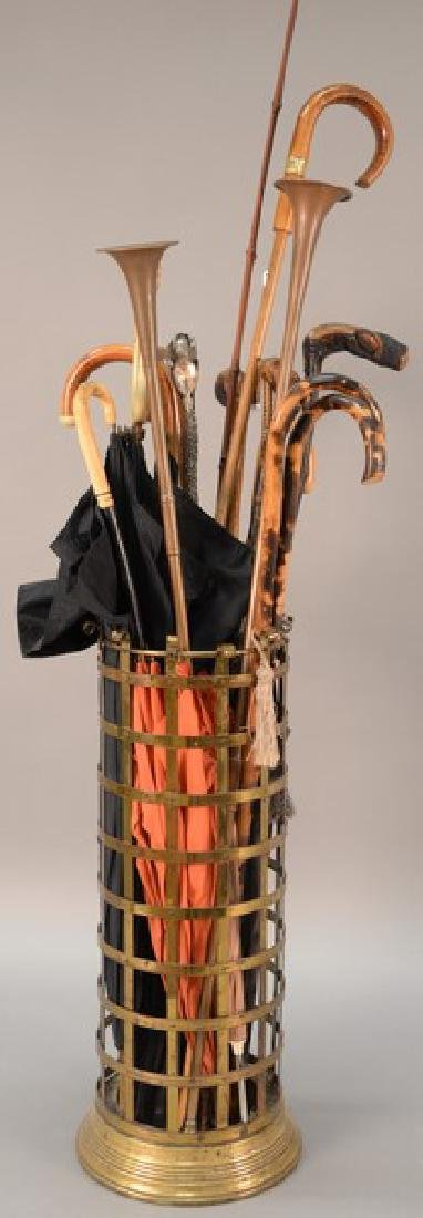 Group of canes, umbrellas, and two copper horns. lg.