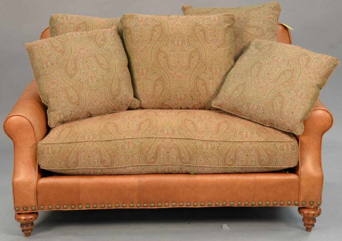 Grange leather loveseat with cloth upholstered