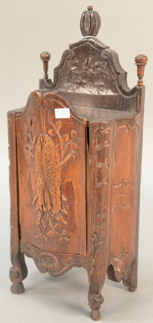 Continental wall box with sliding door having carved