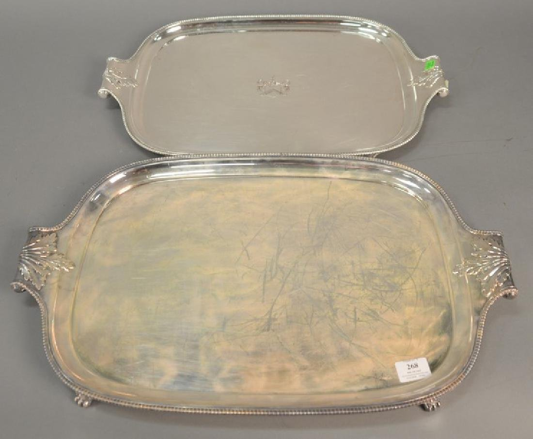Two large silver plated trays having scroll handles.