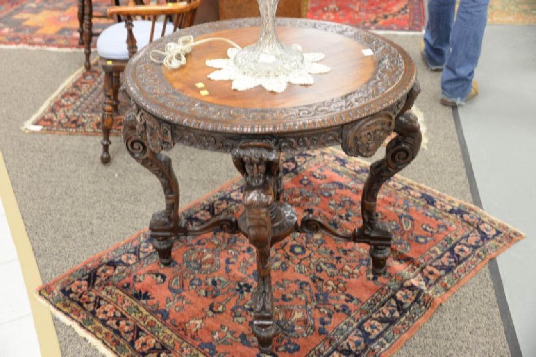 Mahogany round occasional table with carved top and - 2