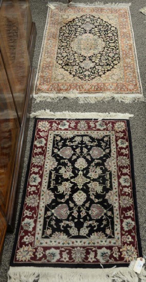 "Two Oriental throw rugs (one silk). 2'6"" x 4' and 2' x"
