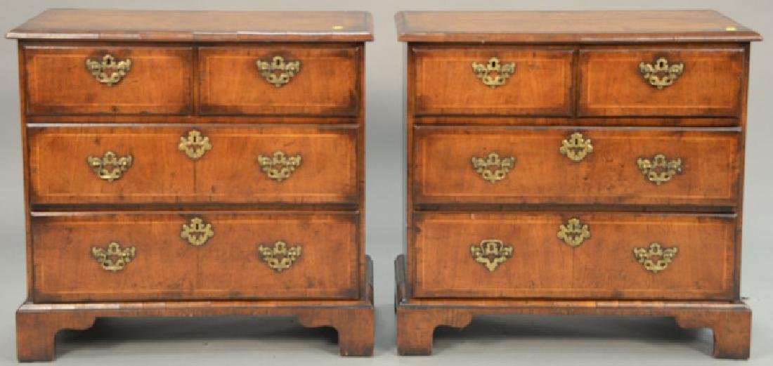 Pair of inlaid diminutive two over two drawer chests.