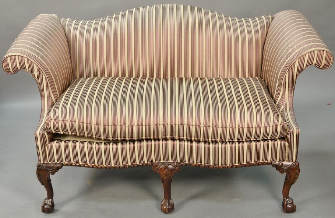 Chippendale style loveseat, upholstery torn top left