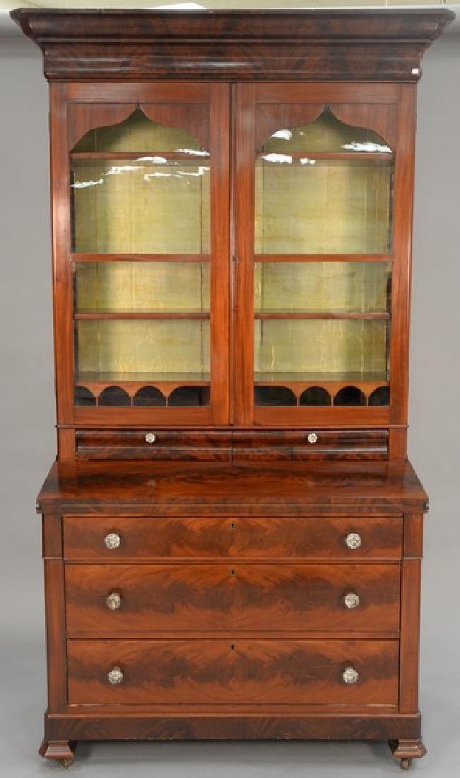 Empire mahogany two part secretary desk, circa 1840.