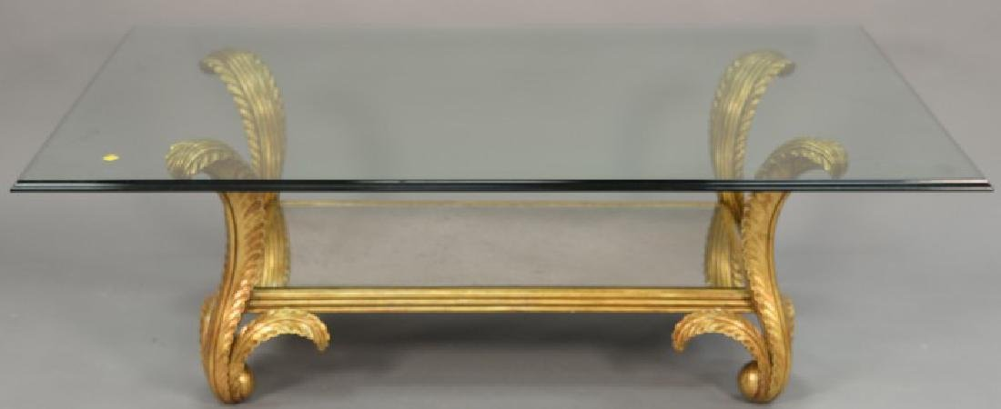 Glass top coffee table having gilt ploom supports. ht.