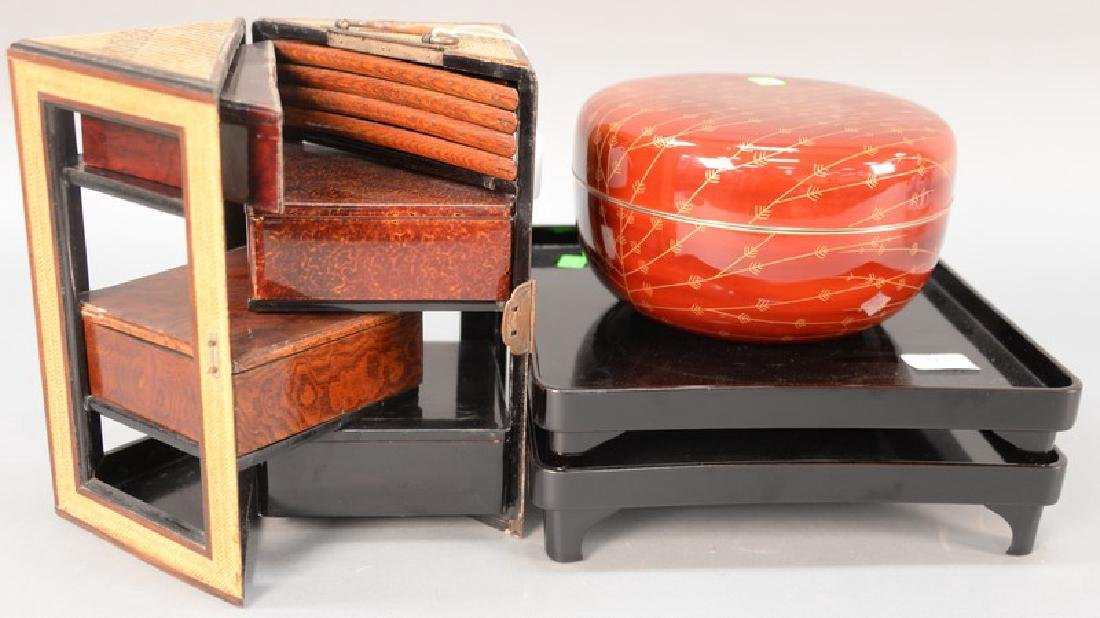 Four piece Japanese lacquered group including a folding