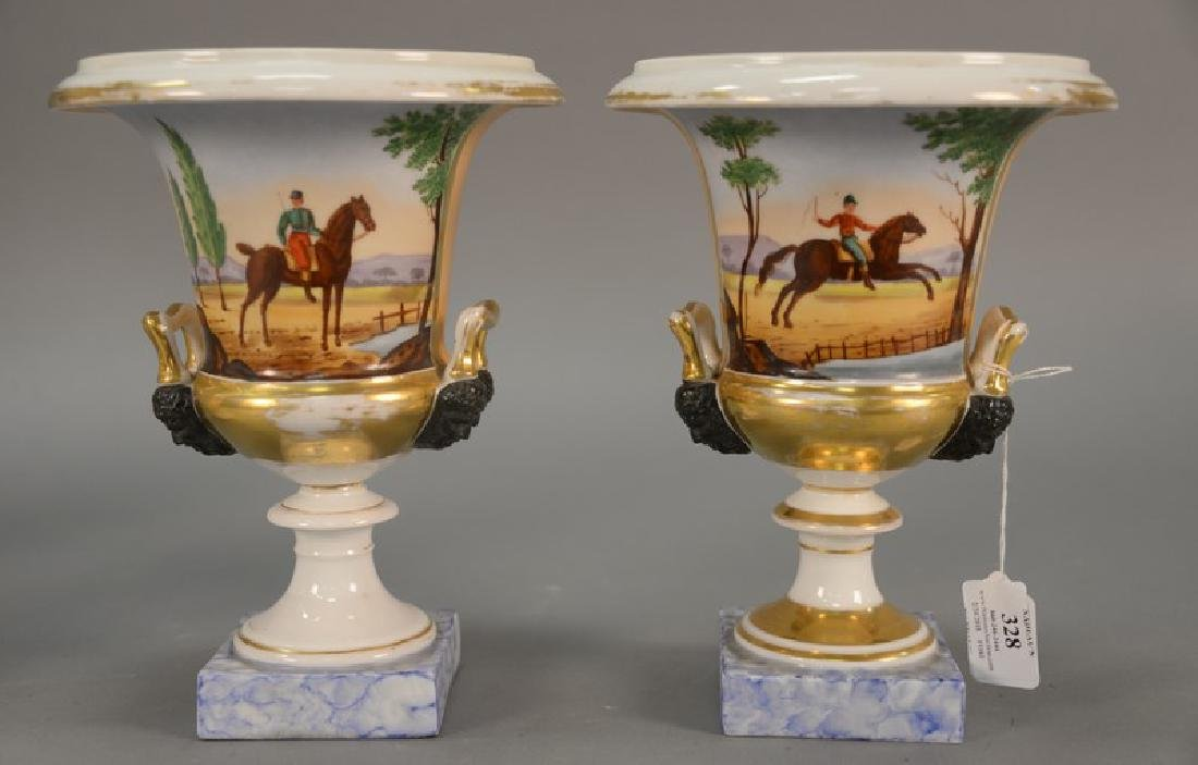 Pair of French porcelain urns with equestrian scene and