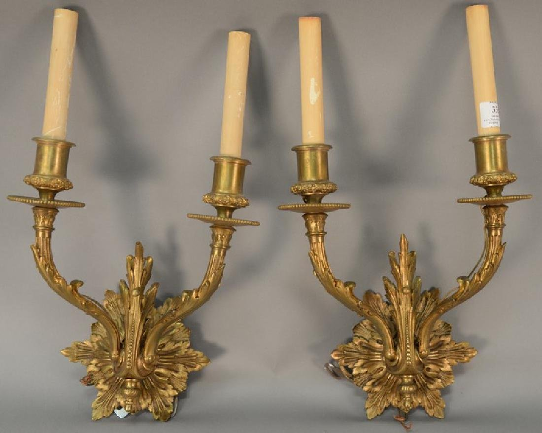 Set of four French style bronze wall sconces, each