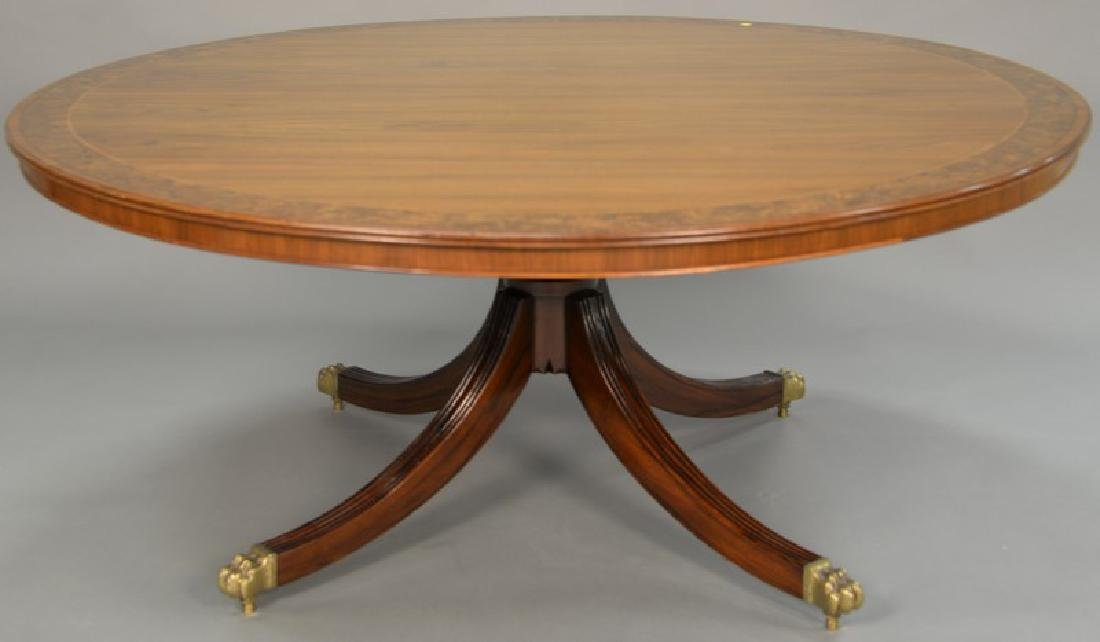 Round mahogany dining table with single pedestal base