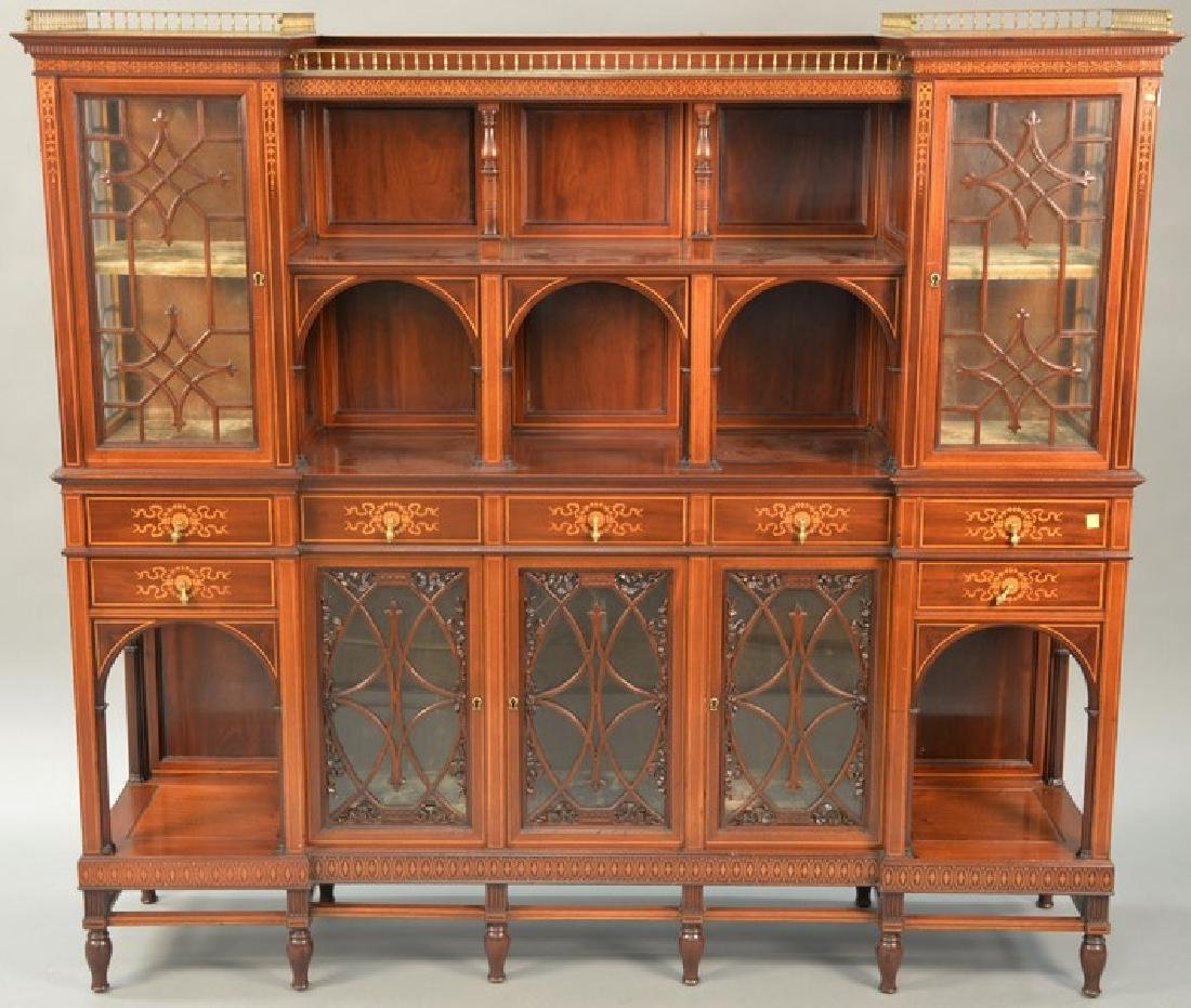 Mahogany etagere with brass rail, door, drawers, and