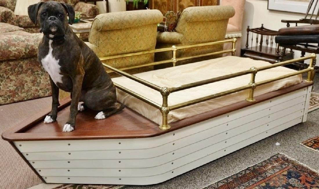 Contemporary boat shaped youth bed with brass rails.